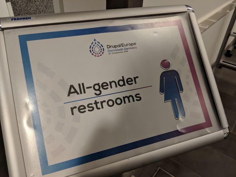 """Sign mentionning """"All-gender restrooms"""" at Drupal Europe venue."""