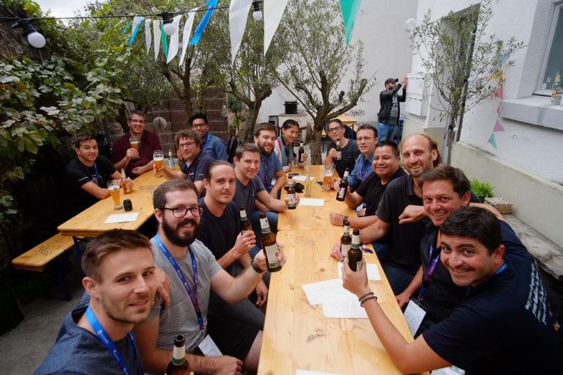 Swiss Drupal community members cheering at a restaurant