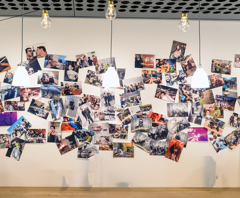 Many different photos from people hanging on the wall