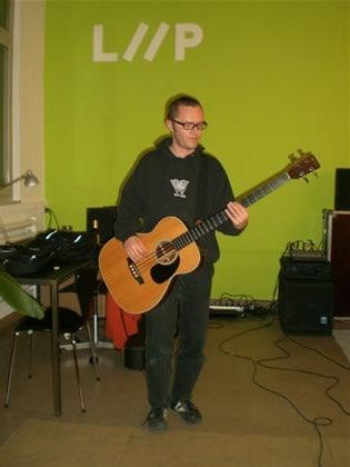 Tinu playing the bass