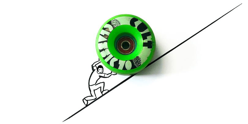 Sisyphus pushing a skateboard wheel up a mountain